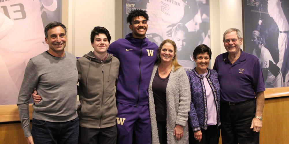 The Rossmeissl and Cummings family with scholarship recipient Jamal Bey